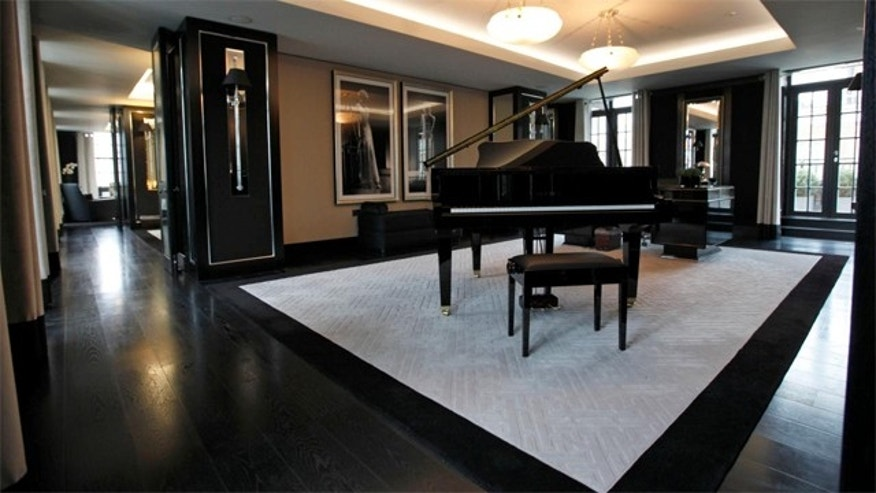 March, 16, 2012:  A reception room with baby grand piano and large desk in one of the five bedroom luxury penthouse apartments overlooking Hyde Park.