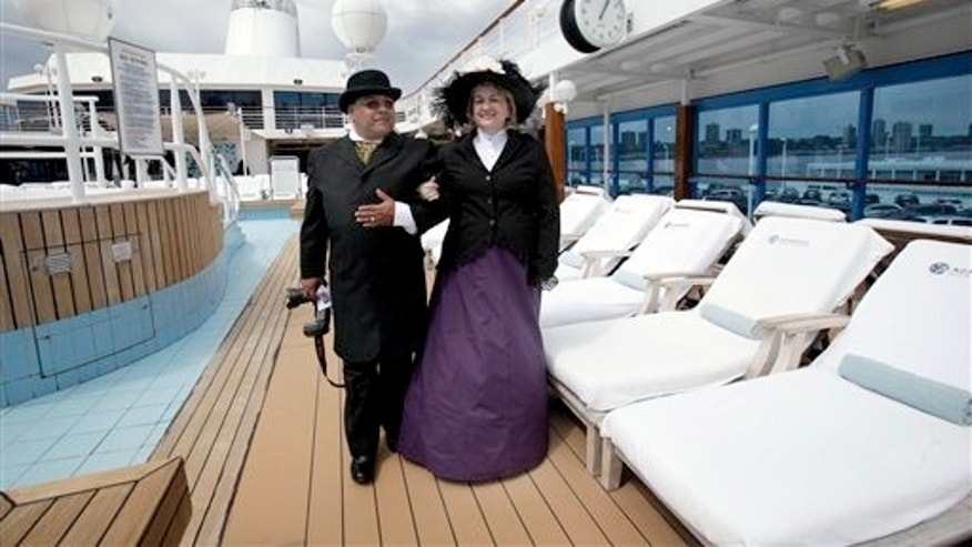April 10, 2012: Laurie and Dan Castaneda, from Long Beach, Calif., walk the pool deck of the Azamara Journey, bound for for Halifax, Nova Scotia.