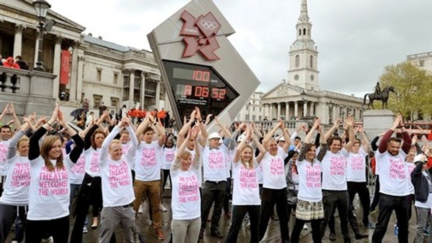 April 18, 2012:  West End theater workers and performers dance in front of the Olympic countdown clock to mark the 100-day countdown.