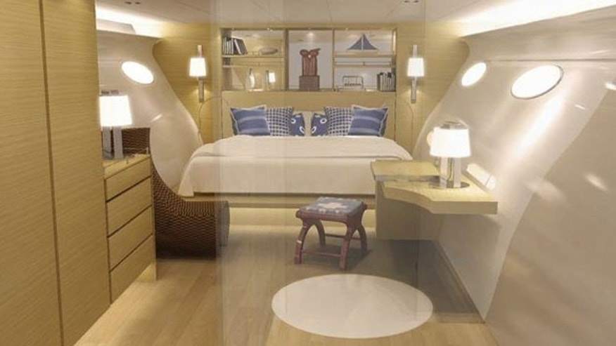 The yacht features a luxurious interior, complete with a dinning area, fancy sleeping spaces, and a bathroom and shower.