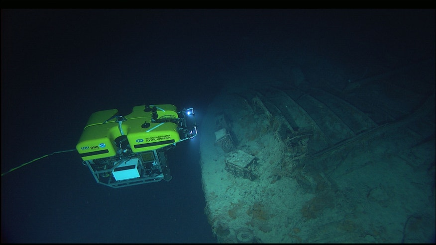 Caption An underwater vessel explores the wreck of the Titanic.