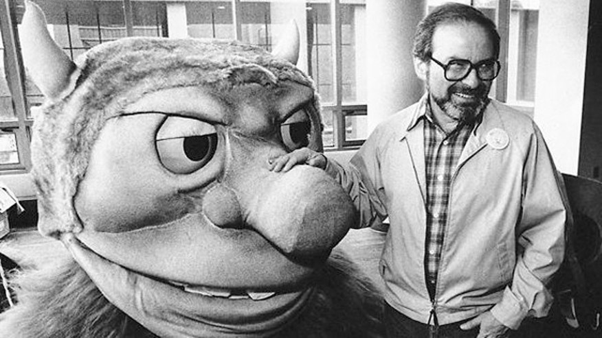 Sept. 25, 1985: Author Maurice Sendak poses with one of the characters from his book Where the Wild Things Are.