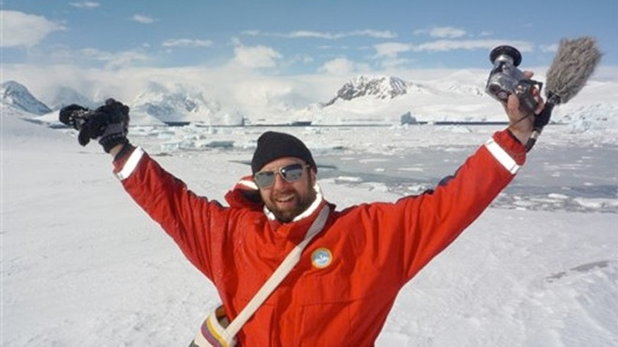 Michael Wigge, in Antarctica at the end of a 25,000-mile trip, that began in Berlin without a penny in his pocket.
