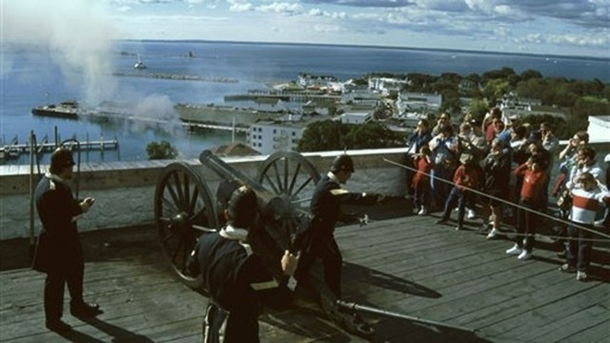 A cannon firing demonstration at by costumed interpreters at Fort Mackinac on Mackinac Island, Mich., on Lake Huron, an important site in the War of 1812.