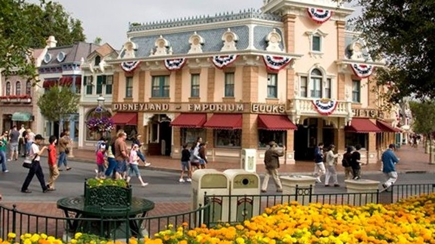 Disney theme parks shows guests on Main Street U.S.A. at the Disneyland theme park in Anaheim, Calif.