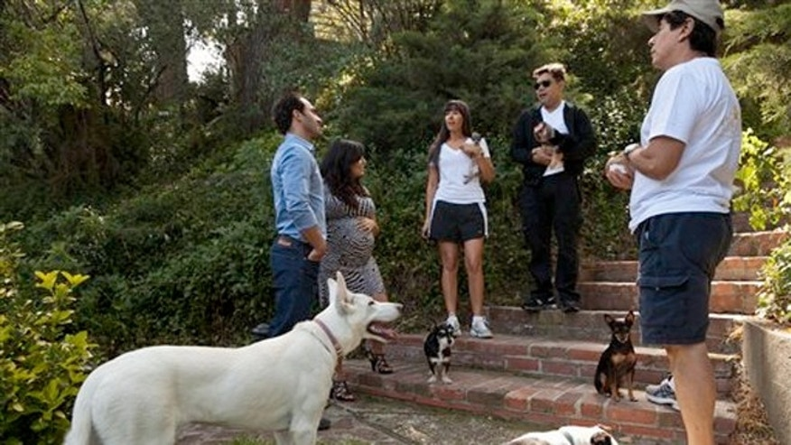 "May 11, 2012: Entrepreneurs Aaron and Karine Hirschhorn, far left, interview with ""Paw Hills"" pet resort owners, the Sorrentini family right, at their home in Woodland Hills area of Los Angeles."