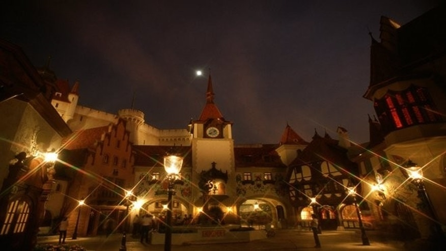 The World Showcase's Germany includes a replica of a medieval castle, miniature German village houses, and model trains.