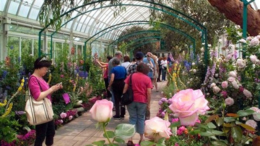 "May 26, 2012: Visitors to the New York Botanical Garden in New York walk through ""Monet's Garden."""