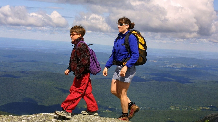 Mother and son hiking on the summit of Mount Mansfield Stowe, Vermont.