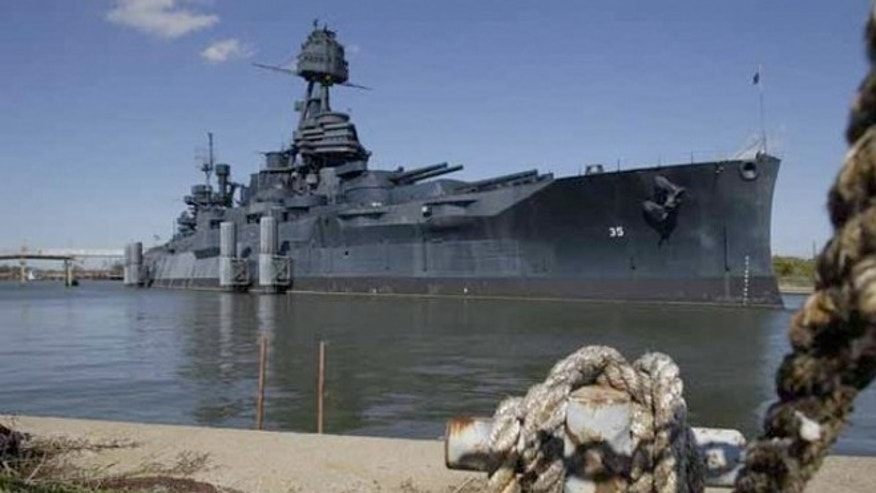 June 13, 2012: An old dock line hangs near the Battleship Texas which sprung a huge leak on Saturday.