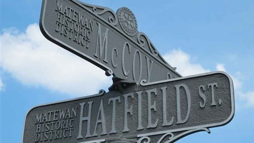 June 9, 2012: A street sign in Matewan, W.Va., that bears the names of the two families that once waged the country's most famous feud in this Appalachian region.