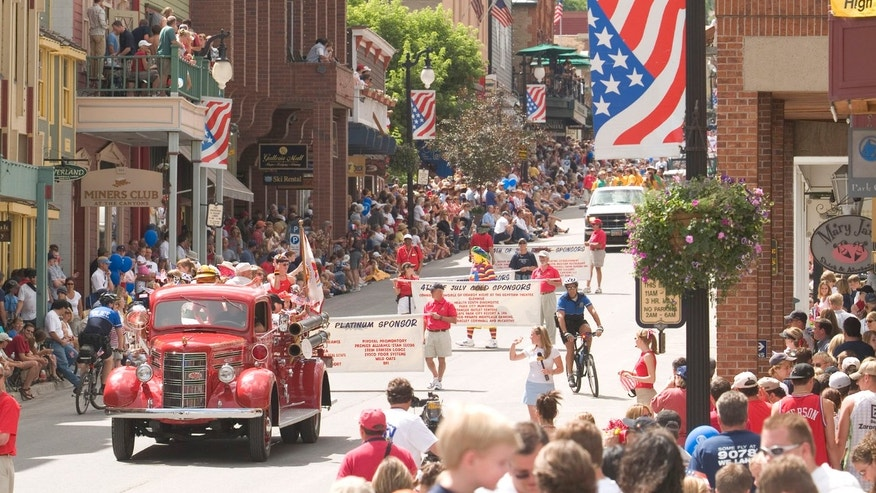 Join the pie eating contest at the Independence Day Parade in Park City, Utah.