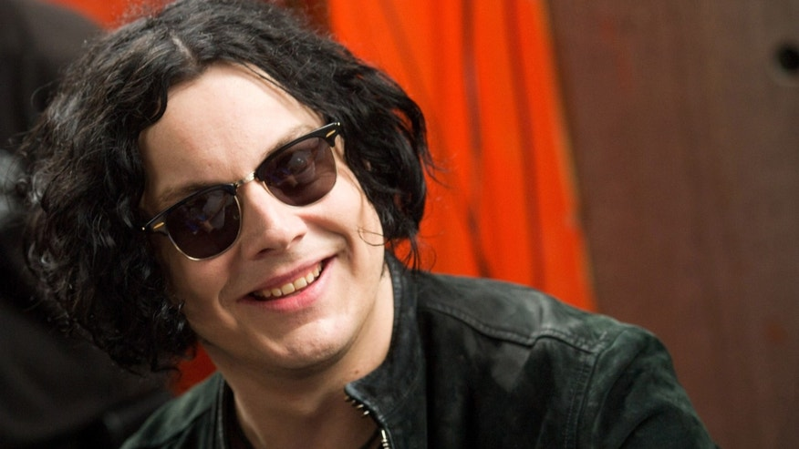 June 24, 2011: Jack White signs copies of the record he made with Stephen Colbert in New York.