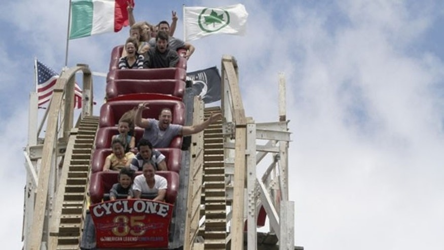 June 26, 2012: Passengers taking a ride on the Cyclone in Coney Island, as the park celebrates the roller coaster's 85th birthday.