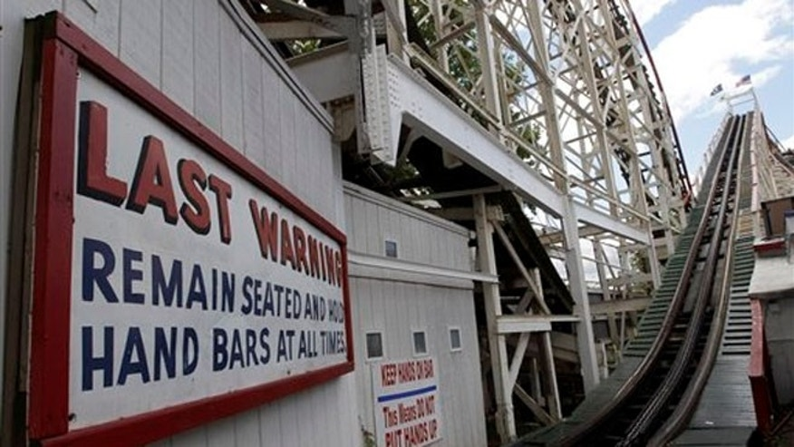 June 26, 2012: Warning signs posted on the Cyclone in Coney Island, NYC.