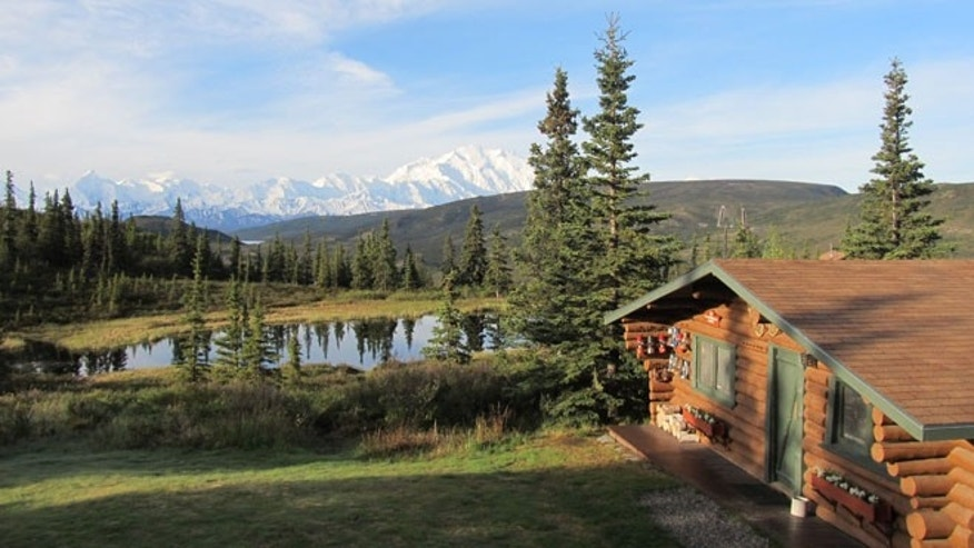 View of Mt. McKinley from the lodge at Camp Denali. Original lodge built 60 years ago is to the right.