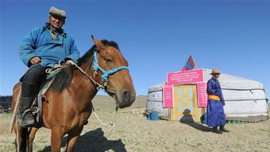 June 28, 2012: A nomad arrives at a yurt in Hovt, western Mongolia.