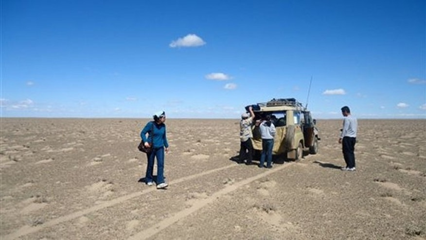 Sept. 8, 2011:  A group of tourists stops on the roadless desert steppes of southern Mongolia for a lunchtime picnic.