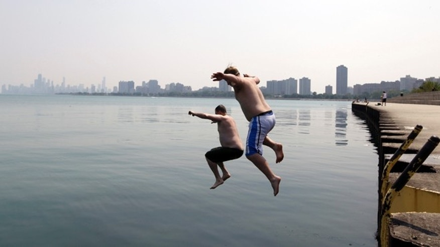 June 28, 2012: Jason Gerald, left, and Adam Hoffman jump into the Lake Michigan at Montrose Beach in Chicago.