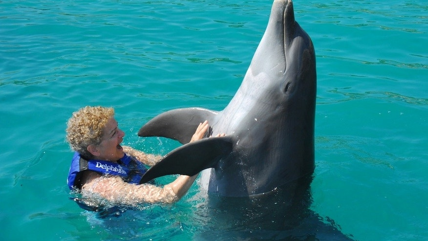 Evelyn Kanter dancing with a dolphin at the nature park, Xcaret, in Riviera Maya, Mexico. (Evelyn Kanter)