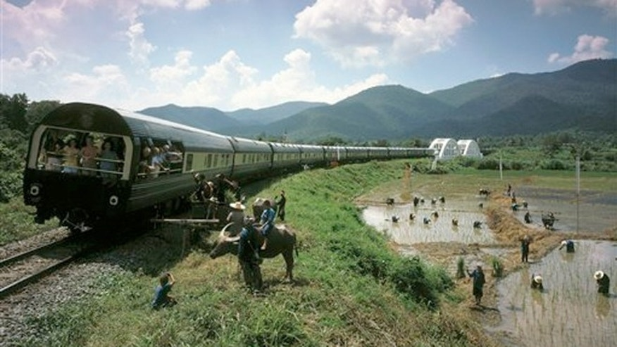 The Eastern & Oriental train crossing the Tha Chompu Bridge near Chiang Mai in Thailand.