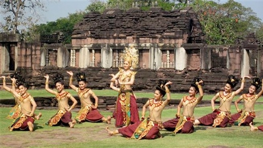 January 2012: Dancers performing for passengers of the Eastern & Oriental train on a scheduled tour stop at Phimai, the site of an ancient Khmer city in Korat, Thailand.