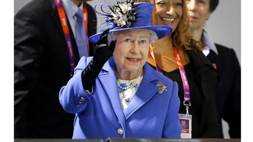 July 28, 2012: Queen Elizabeth II waves to spectators inside the Aquatics center at the 2012 Summer Olympics.