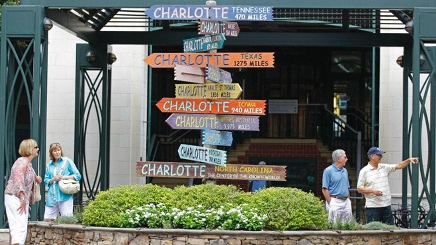 "July 17, 2012: Visitors walk past ""Charlotte"" signs at The Green park."