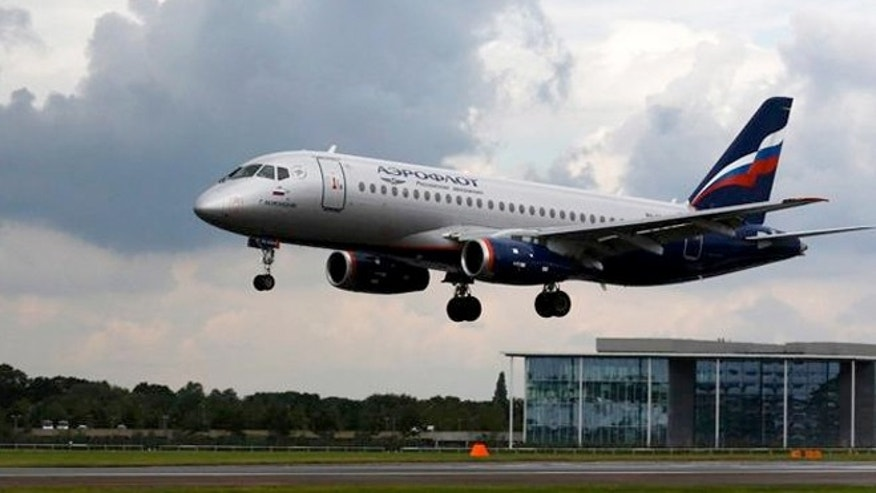 FILE: An Aeroflot jet lands at an airport.  An Aeroflot jet flying from New York to Moscow made an emergency landing in Iceland on Thursday after a caller claimed there was a bomb on board.
