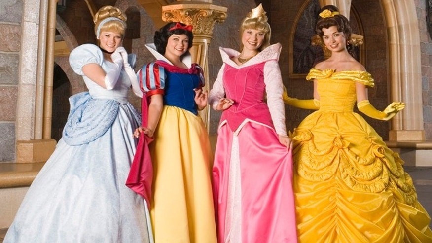Disney princesses Cinderella, Snow White, Aurora and Belle share a royal moment at Disneyland in Anaheim, Calif.