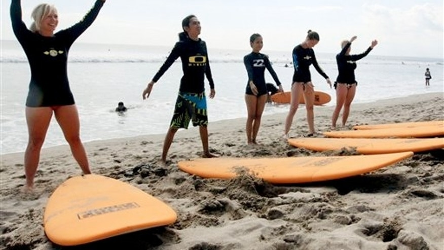 Aug. 25, 2012: Tourists taking a surfing lesson on Kuta beach, Bali, Indonesia.