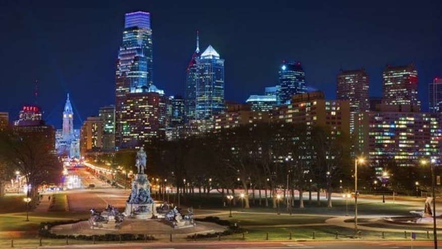 Taken from the steps of the Philadelphia Museum of Art, this nighttime city scene includes the bronze and granite Washington Monument, the culture-heavy Benjamin Franklin Parkway, the iconic City Hall and the towering Comcast Center.