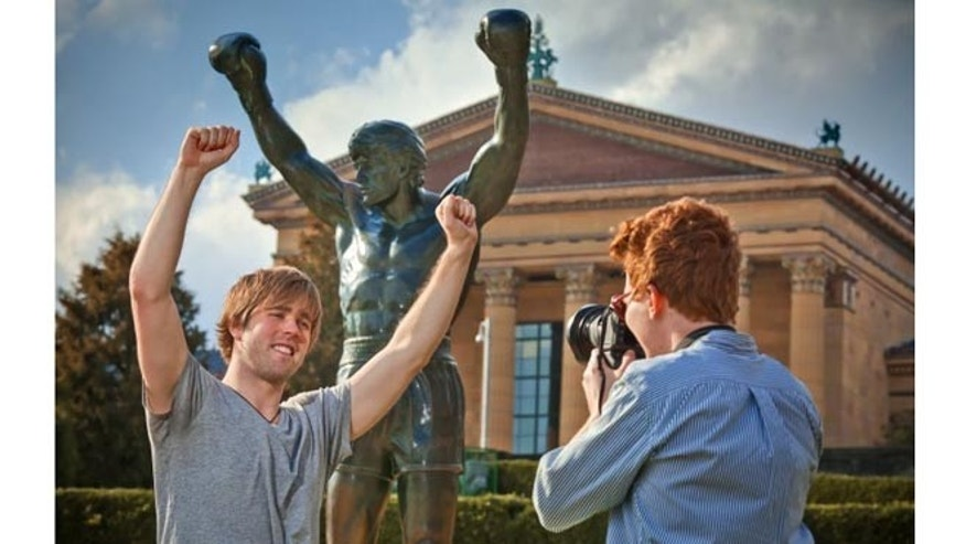 Located at the bottom of the Philadelphia Museum of Art steps—triumphantly scaled by fictional character Rocky Balboa—is a life-size statue of the champion boxer.