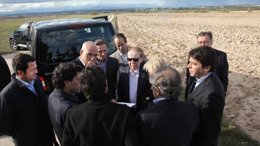 CEO of Las Vegas Sands Corp. Sheldon Adelson, centre with sunglasses, waves while visiting Alcorcon, which was one of the possible sites for the EuroVegas project on the outskirts of Madrid.