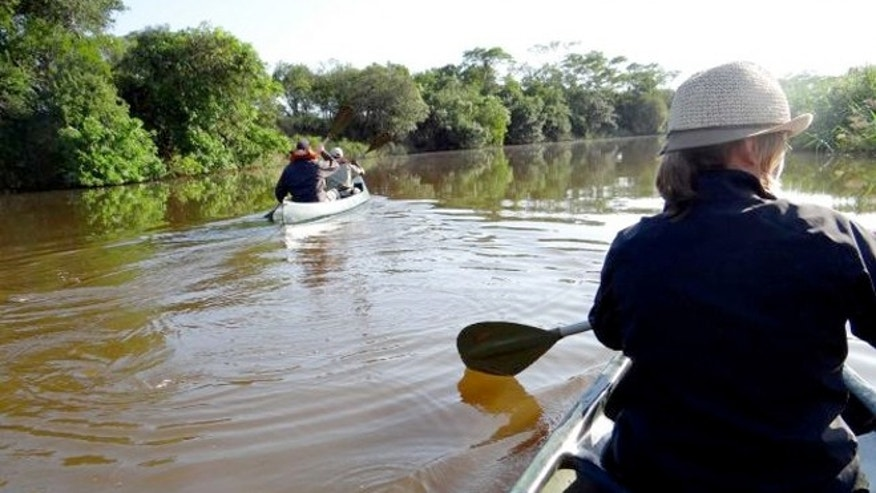 Guests and game rangers paddling along the Mzinene River in the Phinda Private Game Reserve.