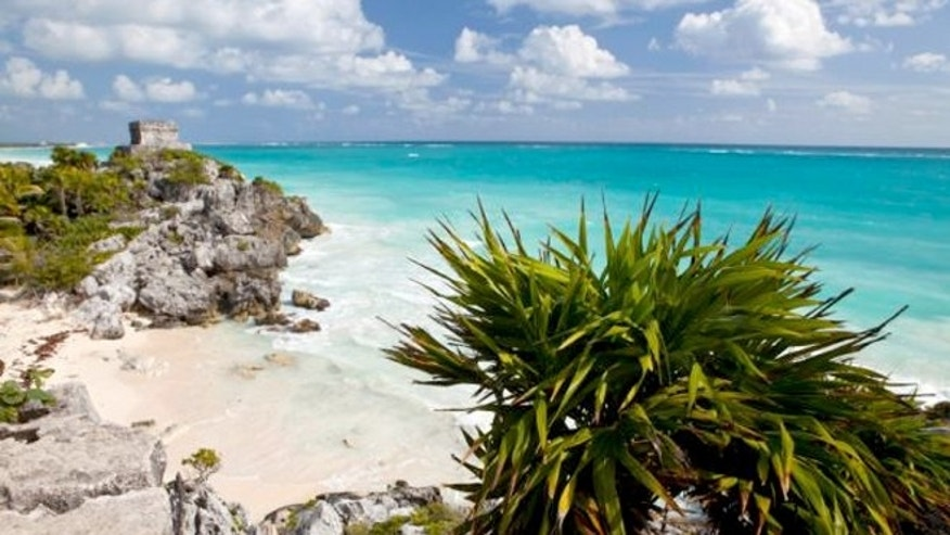 Tulum is on Mexico's Yucatan Peninsula stands on a bluff overlooking the Caribbean Sea.