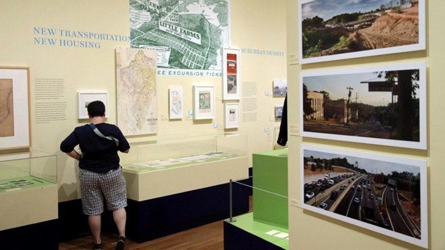 "Sept. 13, 2012: A woman browses the exhibit ""From Farm to City: Staten Island 1661-2012"" at the City of New York Museum."