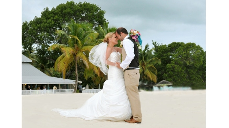 Paul and Polly celebrate through Hurricane Isaac at Jolly Beach Resort + Spa on Antigua.