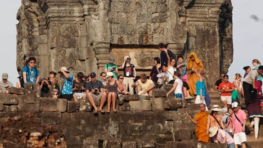 May 11, 2011: Tourists gather on the top of the 10th century temple Bakheng in the Angkor Wat complex near Siem Reap, Cambodia.