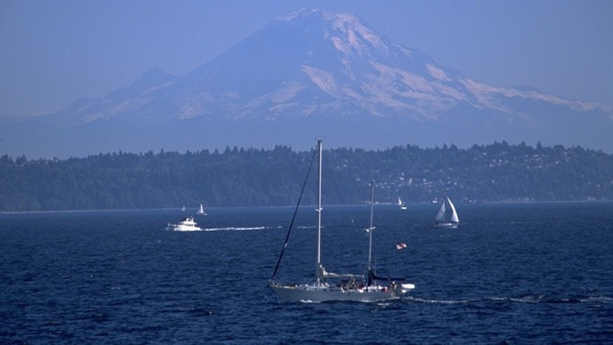 Mount Rainier watches over pleasure boats on Puget Sound.