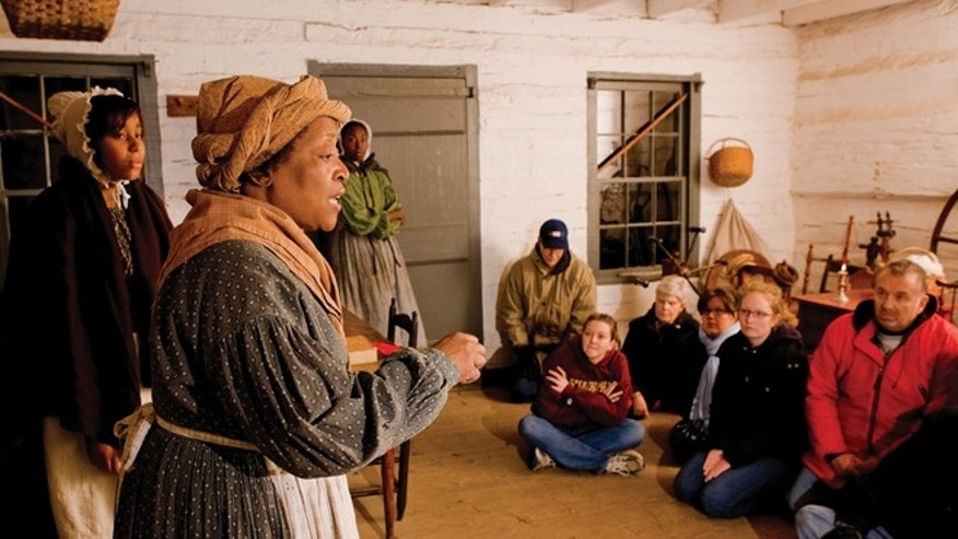 Guests meet former slaves who provide advice on the path to freedom during Follow the North Star at Conner Prairie Interactive History Park.