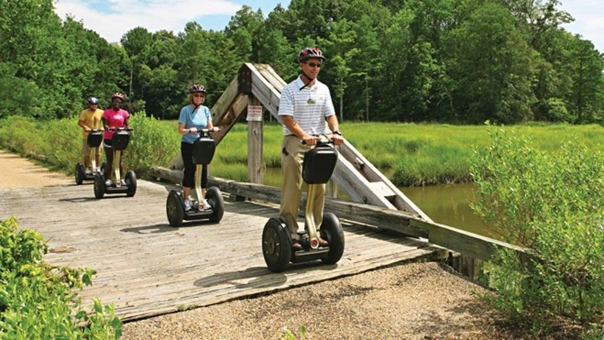 Kingsmill Resorts director of sports, Kevin Dry, leads a Segway tour on the resorts grounds in Williamsburg, Va.