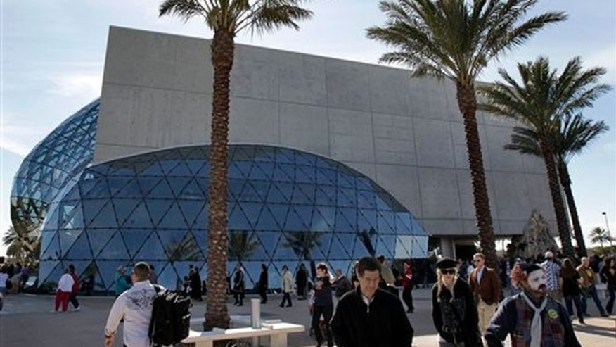 Visitors walk outside the new Salvador Dali museum after grand opening ceremonies in St. Petersburg, Fla.