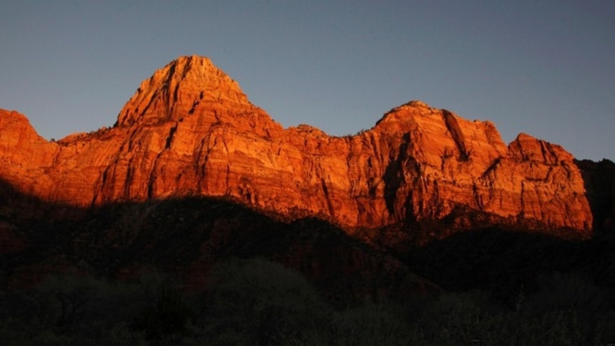 Jan. 20, 2011: This file photo shows shadows creeping up on sandstone cliffs glowing red as the sun sets on Zion National Park near Springdale, Utah.