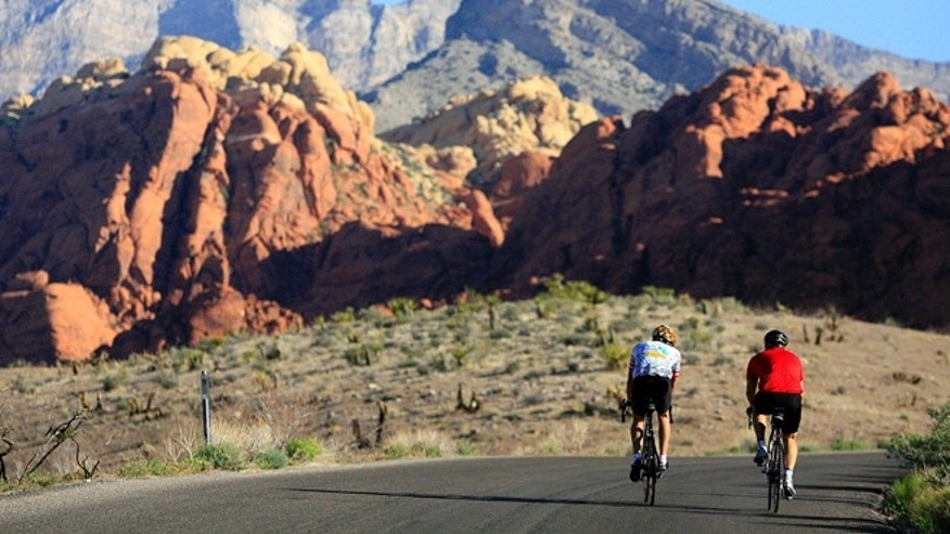 May 6, 2006: This file photo shows two cyclists riding along the 13-mile-long scenic drive at Red Rock Canyon National Conservation Area in Nevada.