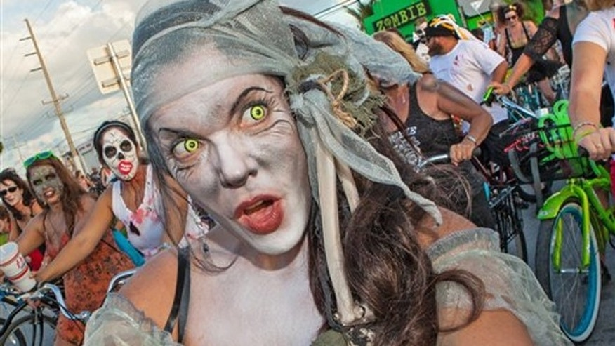 A participant in the Zombie Bike Ride makes her way down a street in Key West, Fla.