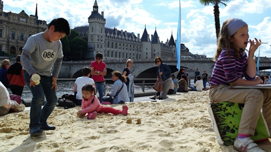 July 20, 2012: Children play in sand during the Paris Plages event.