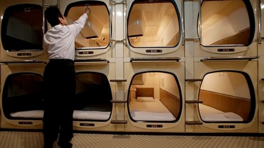 Squeezing into a capsule hotel room in japan fox news for Small hotel room