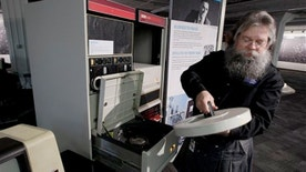 Oct. 30, 2012: Ian King, senior vintage systems engineer at the Living Computer Museum in Seattle, loads a large disk drive that holds 5mb of data into a working DEC 11/70 minicomputer from 1975.