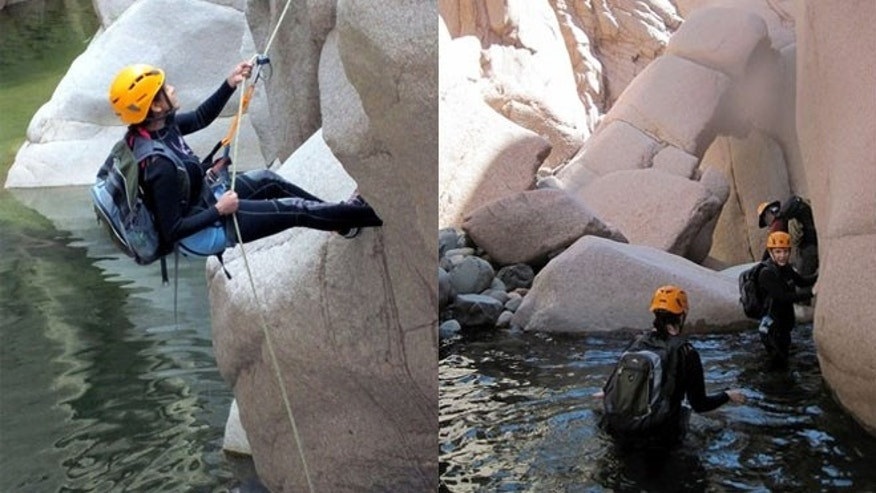 April 19, 2012: Hikers in wetsuits and helmets wading in Salome Creek in Salome Canyon, in Arizona's Tonto National Forest.